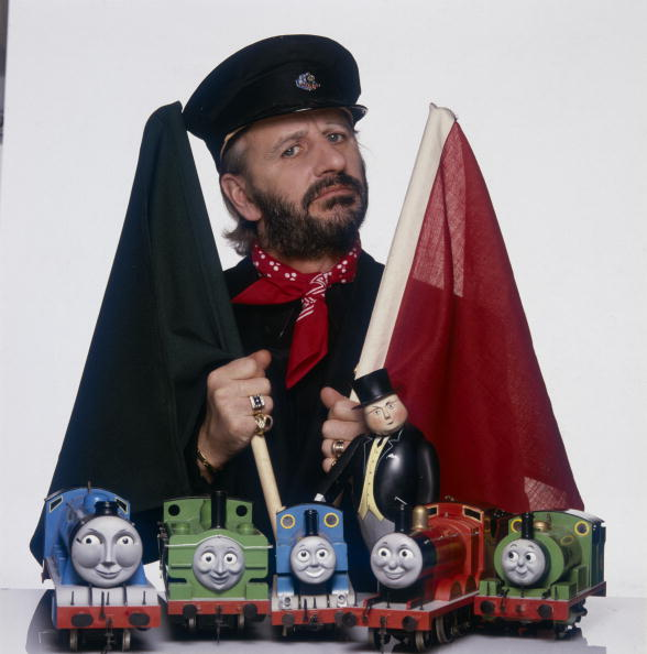 Former Beatles drummer Ringo Starr with models of the Fat Controller and train characters from the TV series 'Thomas The Tank Engine', which he narrates, circa 1985. (Photo by Terry O'Neill/Hulton Archive/Getty Images)